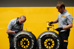 Pirelli tyre technicians with Renault Sport F1 Team tyres