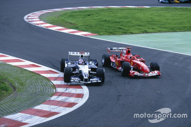 Juan Pablo Montoya, Williams overtakes Michael Schumacher, Ferrari at Bus stop