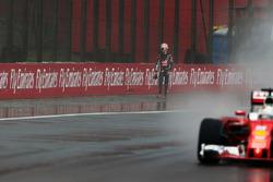 Sebastian Vettel, Ferrari SF16-H passes Romain Grosjean, Haas F1 Team, who crashed on the way to the grid