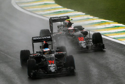 Fernando Alonso, McLaren MP4-31 leads team mate Jenson Button, McLaren MP4-31