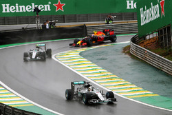 Lewis Hamilton, Mercedes AMG F1 W07 Hybrid leads team mate Nico Rosberg, Mercedes AMG F1 W07 Hybrid and Max Verstappen, Red Bull Racing RB12 out of the pits