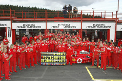Michael Schumacher, Ferrari F2004 celebrates with the Ferrari team after winning his 7th world championship
