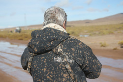 Red Bull photographer covered in mud