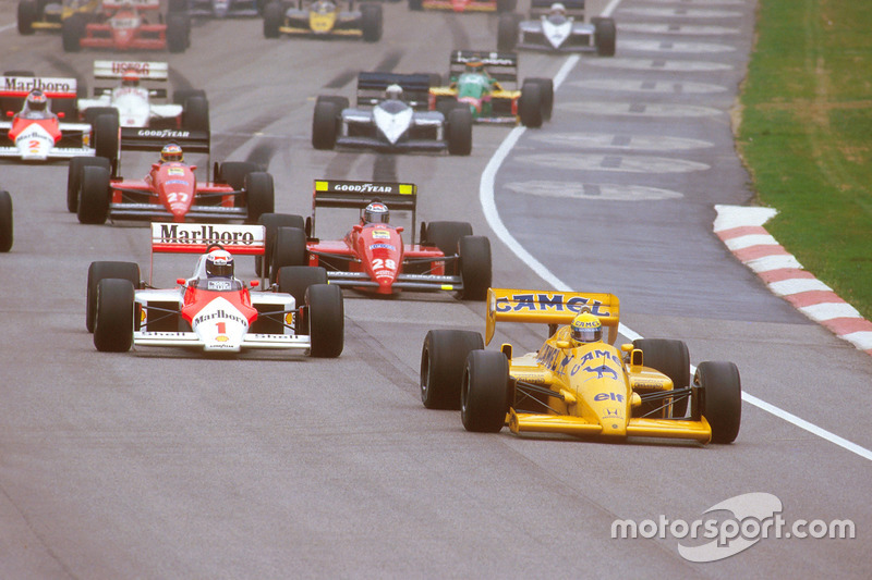 Ayrton Senna, Lotus 99T Honda, leads Alain Prost, McLaren MP4/3 TAG Porsche, and Gerhard Berger, Ferrari F187, at the start