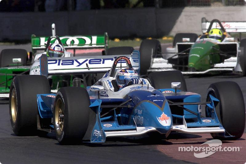 Alex Tagliani leading Dario Franchitti and Christian Fittipaldi