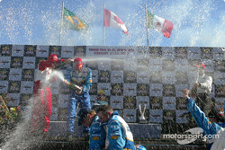 The podium: champagne for race winner Paul Tracy, Michel Jourdain Jr. and Bruno Junqueira