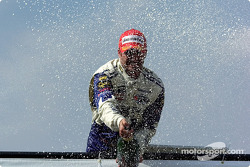 Podium: champagne for Alex Tagliani