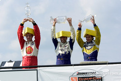 A Frenchman, a Canadian, and a Mexican wearing cheeseheads. Where else but Champ Car?