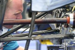 Forsythe Championship Racing crew member prepares rear suspension