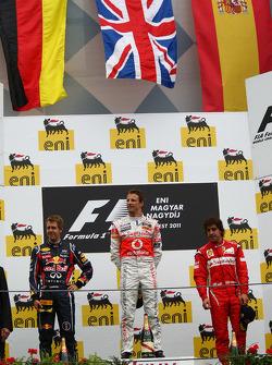 Podium: race winner Jenson Button, McLaren Mercedes, second place Sebastian Vettel, Red Bull Racing, third place Fernando Alonso, Scuderia Ferrari