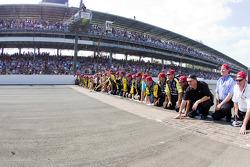 Victory lane: race winner Paul Menard, Richard Childress Racing Chevrolet celebrates with his team by kissing the yard of bricks