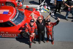 Race winners Jon Fogarty and Alex Gurney celebrate with Bob Stallings