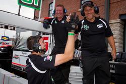 Dyson Racing team members celebrate pole position