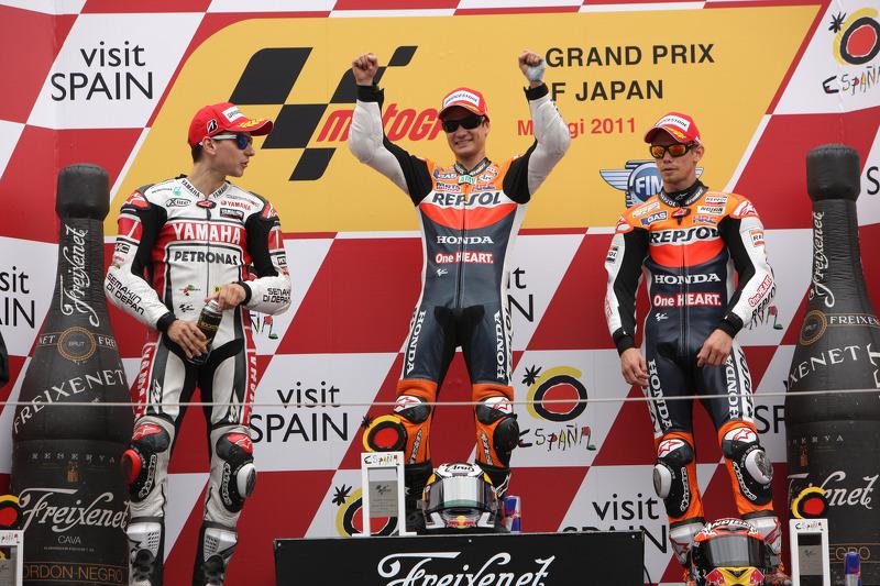 Podium 2011: Pemenang balapan, Dani Pedrosa, peringkat kedua Jorge Lorenzo, peringkat ketiga Casey Stoner