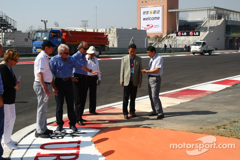 Charlie Whiting, FIA Safty delegate, Race director & offical starter looking at the circuit
