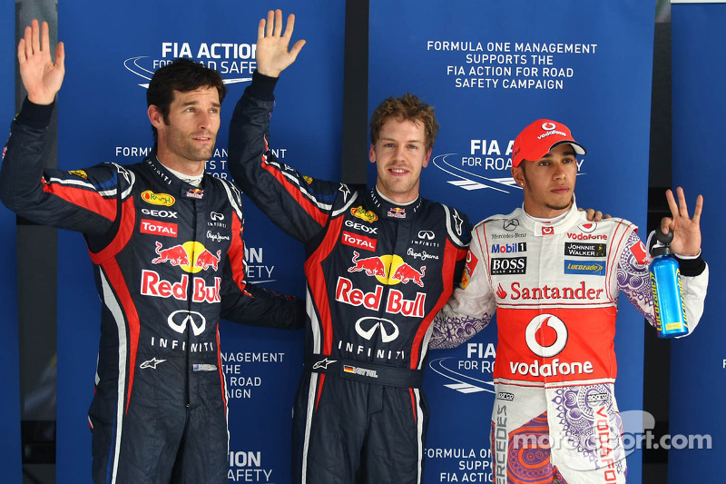 Mark Webber, Red Bull Racing with poleman Sebastian Vettel, Red Bull Racing and Lewis Hamilton, McLa