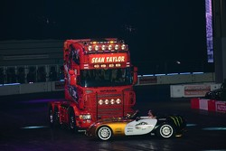 Terry Grant, donuts his TVR around a Scania R580 rig - while the truck is moving
