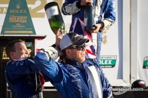 DP podium: A.J. Allmendinger celebrates with Michael Shank