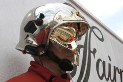 Daniel Ricciardo, Red Bull Racing RB13 reflected in a fire marshals helmet