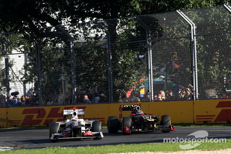 Sergio Pérez, Sauber F1 Team y Kimi Raikkonen, Lotus F1 Team