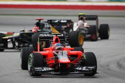 Ciaron Pilbeam, Red Bull Racing Race Engineer leads Heikki Kovalainen, Caterham