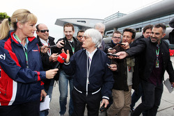 Bernie Ecclestone, CEO Formula One Group, with Rachel Brookes, Sky Sports News Presenter, and othe members of the media