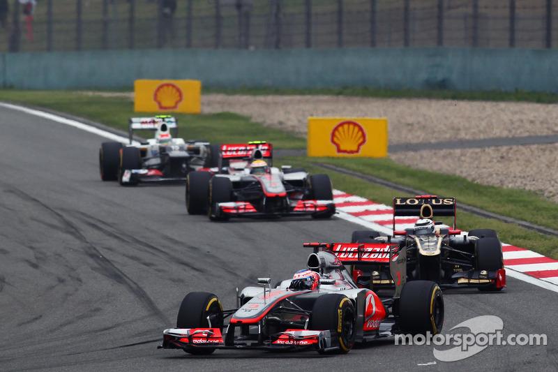 Jenson Button, McLaren en Kimi Raikkonen, Lotus