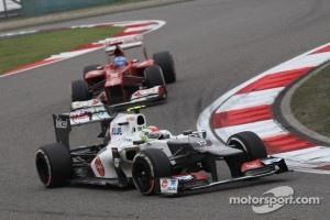 Sergio Perez, Sauber F1 Team leads Fernando Alonso, Scuderia Ferrari