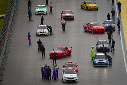 Cars head to starting grid on the track
