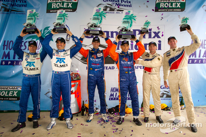 DP podium: class and overall winners Max Angelelli and Ricky Taylor, second place Scott Pruett and M