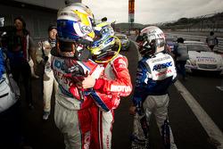 GT500 race winner Hiroaki Ishiura celebrates with Satoshi Motoyama