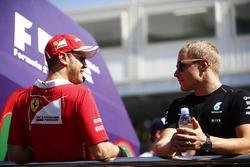 Sebastian Vettel, Ferrari, talks to Valtteri Bottas, Mercedes AMG F1