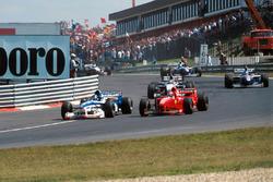 Damon Hill. Arrows A18 ve Michael Schumacher, Ferrari F310B