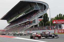 Fernando Alonso, Scuderia Ferrari passes pole sitter Pastor Maldonado, Williams at the start of the race