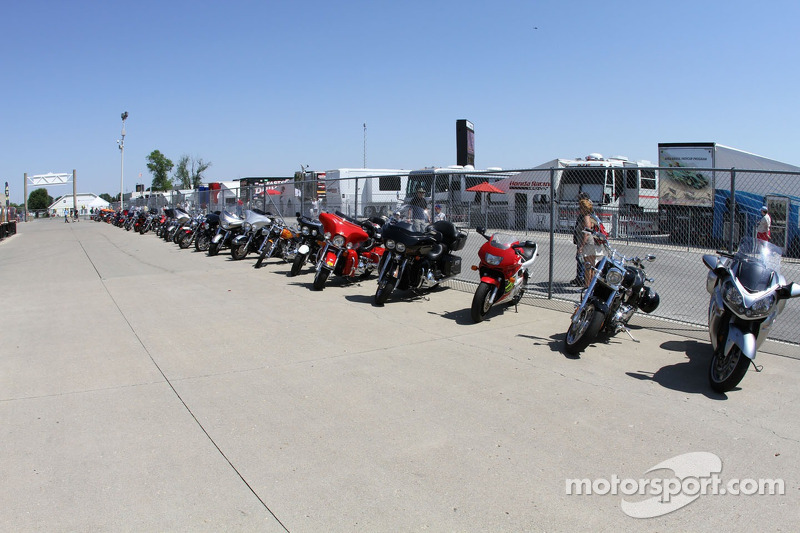 Motorcycles line the fence in Gasoline Alley