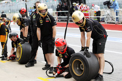 Lotus F1 Team prepare to practice a pit stop