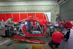 AF Corse team members work to repair the #51 AF Corse Ferrari 458 Italia