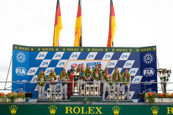 LMP1 podium: class and overall winners Marcel Fässler, Andre Lotterer, Benoit Tréluyer, second place Rinaldo Capello, Tom Kristensen, Allan McNish, third place Oliver Jarvis, Marco Bonanomi, Mike Rockenfeller