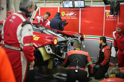 Mechanic are working on the Car of #61 AF Corse-Waltrip Ferrari F458 Italia: Robert Kauffman, Rui Aguas, Brian Vickers