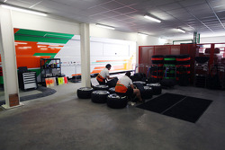Sahara Force India F1 Team mechanics in the garage area