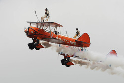 AeroSuperBatics display the Breitling Wingwalkers formation team