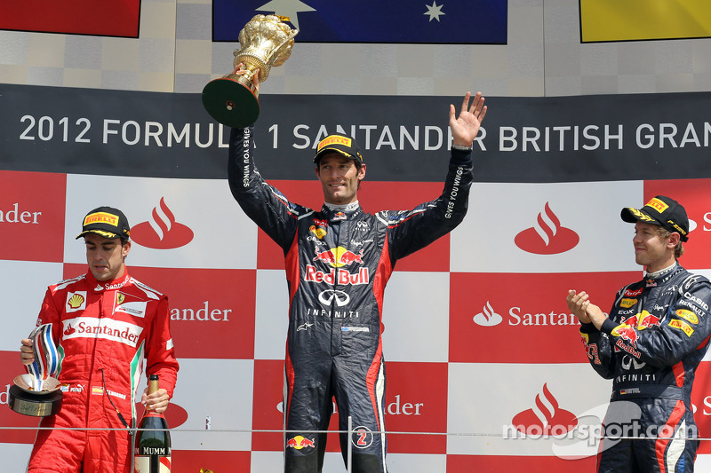 Podium: race winner Mark Webber, second place Fernando Alonso, third place Sebastian Vettel