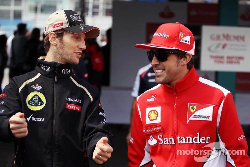 Romain Grosjean, Lotus F1 Team met Fernando Alonso, Ferrar, rijdersparade