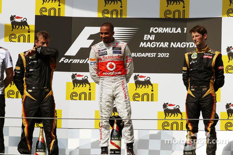 المركز الأول لويس هاميلتون، المركز الثاني كيمي رايكونن، المركز الثالث رومان غروجان