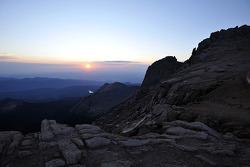 The sun rises over Pikes Peak