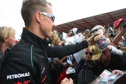 Michael Schumacher, Mercedes GP  signing autographs for the fans