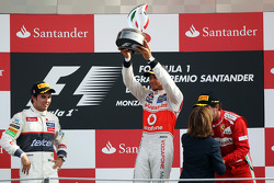 Podium: race winner Lewis Hamilton, McLaren Mercedes, second place place Sergio Perez, Sauber F1 Team