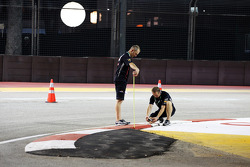 Red Bull Racing measure the height of the gap in the kerb