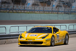 #23 Ferrari of Central Florida 458TP: Onofrio Triarsi races down pitlane after a collision with #68 Ferrari of San Francisco 458CS: Mike Hedlund