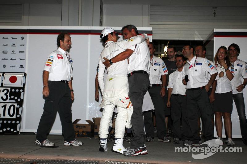 Kamui Kobayashi, Sauber celebrates his third position with Beat Zehnder, Sauber F1 Team Manager and the team